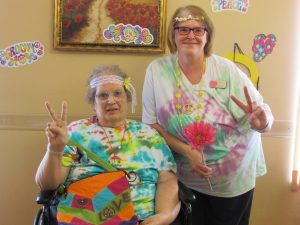 Lodger Linda and Linda from Activities giving a peace sign on National Hippie Day